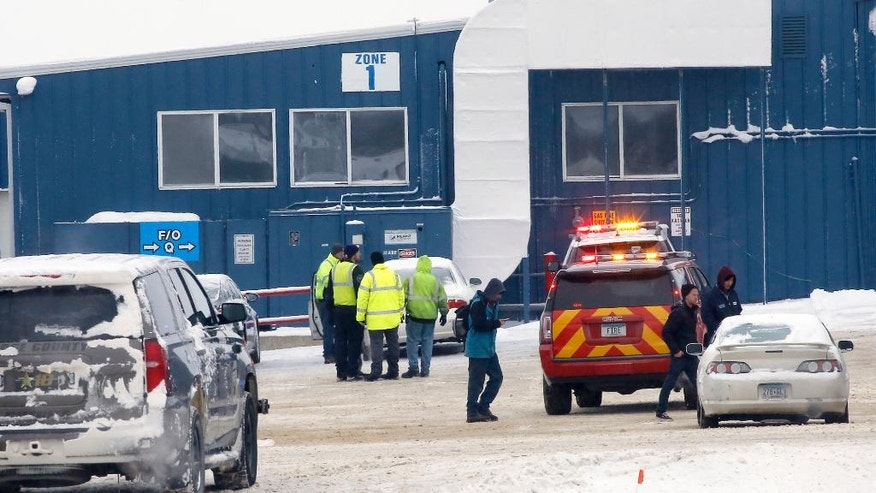 Emergency responders talk outside Mc Neilus Truck and Manufacturing after a possible explosion Wednesday Jan. 11 2017 in Dodge Center Minn