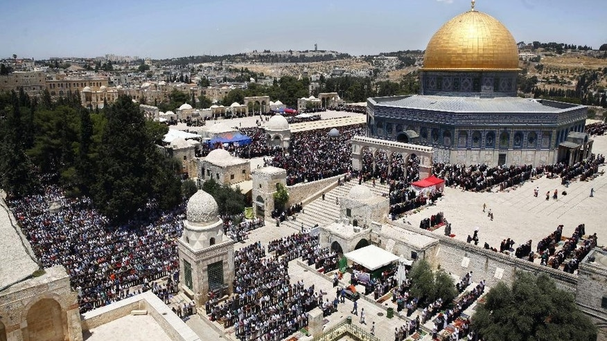FILE - In this June 17, 2016 file photo, Palestinians pray in the Al Aqsa Mosque compound during the Muslim holy month of Ramadan, in Jerusalem's Old City. The Palestinians are ringing alarm bells over Donald Trump's stated intention to relocate the U.S. Embassy in Israel to contested Jerusalem, fearing quick action once he takes office as U.S. president next week. They say an embassy move would kill any hopes for negotiating an Israeli-Palestinian border deal and rile the region by undercutting Muslim and Christian claims to the holy city. (AP Photo/Mahmoud Illean, File)