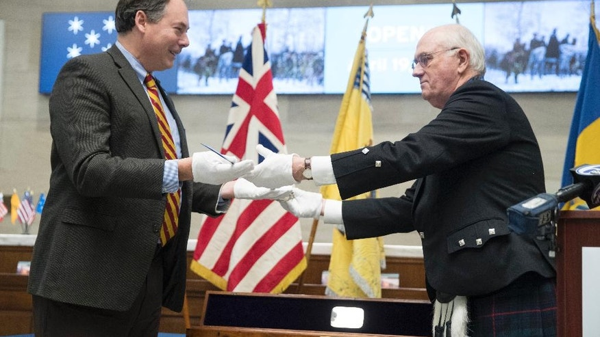 Stephen W. Armstrong, President of the St. Andrew's Society of Philadelphia presents the Museum of the American Revolution represented by R. Scott Stephenson with a sword that belonged to General Hugh Mercer on the 240th university of his death, Thursday, Jan. 12, 2017, in Philadelphia. Mercer who was a friend of George Washington fought and died of wombs sustained during the American Revolution. (AP Photo/Matt Rourke)