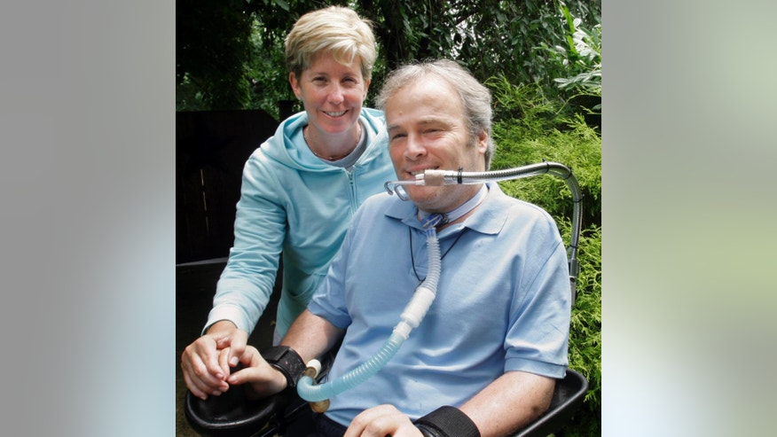 FILE - In this July 5, 2006 file photo, paralyzed New York City police officer Steven McDonald poses with his wife, Patti McDonald at their home in Malverne, N.Y. McDonald, who was paralyzed by a bullet and became an international voice for peace after he publicly forgave the gunman, died Tuesday, Jan. 10, 2017 at the age of 59. (AP Photo/Bebeto Matthews, File)