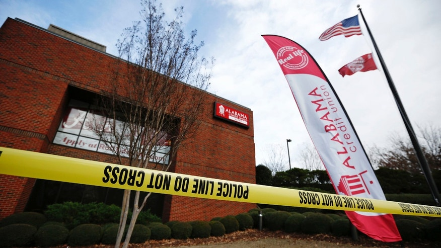 Police tape surrounds the Alabama Credit Union building after reports of a hostage standoff, Tuesday, Jan. 10, 2017, in Tuscaloosa, Ala.
