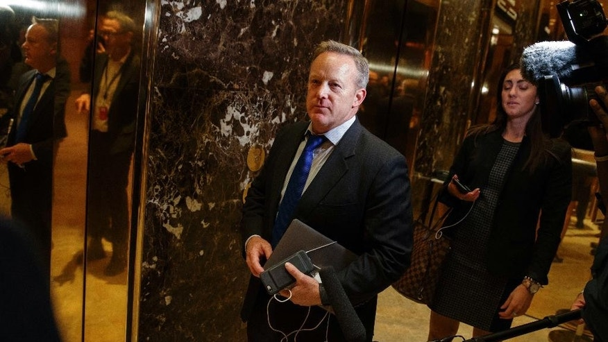 FILE - In this Nov. 14, 2016 file photo, Sean Spicer arrives at Trump Tower in New York. The Obama administration is aware of frequent contacts between President-elect Donald Trump's top national security adviser Michael Flynn and Russia's ambassador to the U.S., including on the day President Barack Obama hit Moscow with sanctions in retaliation for election-related hacking, a senior U.S. official said Friday, Jan. 13, 2017.   (AP Photo/ Evan Vucci, File)