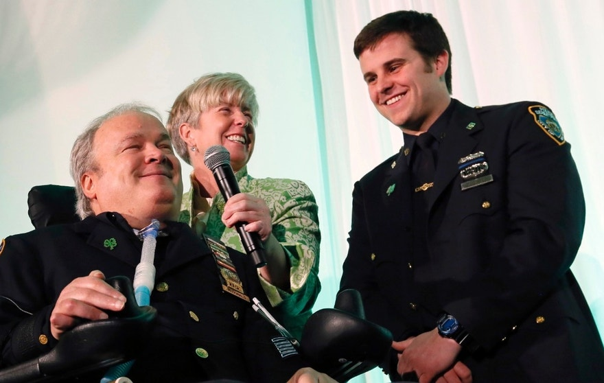 FILE - In this March 15, 2015 file photo, New York City Detective Steven McDonald, his wife Patti, and son, Conor, smile after receiving the Spirit of Giving Award at the Kelly Cares Foundation's 5th Annual Irish Eyes Gala held at the JW Marriot Essex House in New York. McDonald, who was paralyzed by a bullet and became an international voice for peace after he publicly forgave the gunman, died Tuesday, Jan. 10, 2017 at the age of 59. (Photo by Stuart Ramson/Invision for Kelly Cares Foundation/AP Images, File)