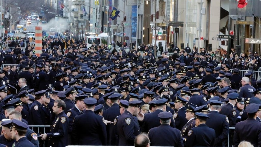 Police officers fill New York's Fifth Avenue prior to the funeral for Steven Mc Donald at St. Patrick's Cathedral Friday Jan. 13 2017. Mc Donald died on Tuesday 30 years after a robbery suspect shot him in Central Park. The officer publicly