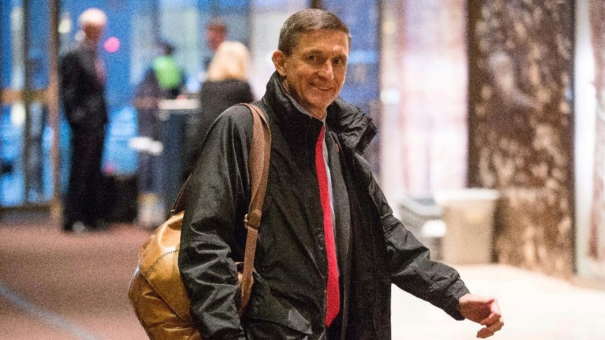 FILE - In this Jan. 3, 2017 file photo, National Security Adviser-designate Michael Flynn arrives at Trump Tower in New York. Some of President-elect Donald Trump's most important Cabinet choices are at odds with him on matters that were dear to his heart as a campaigner and central to his promises to supporters. For the Pentagon, the CIA, the State Department and more, Trump has picked people who publicly disagree with him on some cornerstones of his agenda In confirmation hearings.(AP Photo/Andrew Harnik, File)