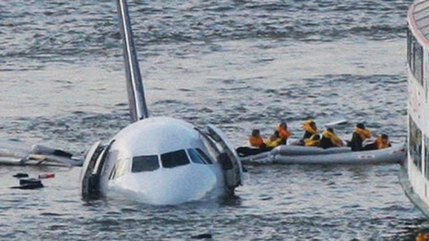 Passengers in an inflatable raft after Airbus 320 US Airways jet landed in the Hudson River in New York in 2009.