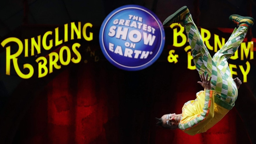 A Ringling Bros. and Barnum & Bailey clown does a somersault during a performance Saturday, Jan. 14, 2017, in Orlando, Fla.