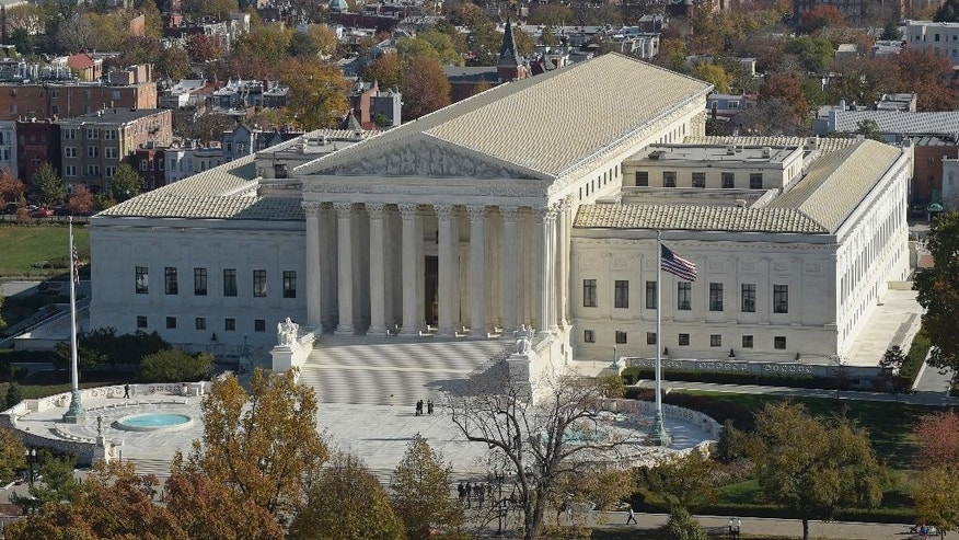 This Nov. 15, 2016 photo shows a view of the Supreme Court from the Capitol Dome, on Capitol Hill in Washington. An Asian-American rock band called the Slants has spent years locked in a legal battle with the government over its refusal to trademark the band's name.  The fight will play out Wednesday at the Supreme Court as the justices consider whether a law barring disparaging trademarks violates the band's free speech rights.  (AP Photo/Susan Walsh)