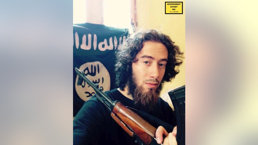 In this undated photo provided by the United States Attorney for the Southern District of New York, Samy el-Goarany poses for a photo with a weapon and the Islamic State group flag. Prosecutors showed this photo of Samy el-Goarany in federal court Tuesday, Jan. 17, 2017, during the trail of Ahmed Mohammed el-Gammal who is accused of helping Samy el-Goarany reach Syria where he trained with the Islamic State group before he was killed. The photo was shown while Samy el-Goarany's brother, Tarek el-Goarany, was testifying. (U.S. Attorney's Office for the Southern Distirct of New York via AP)