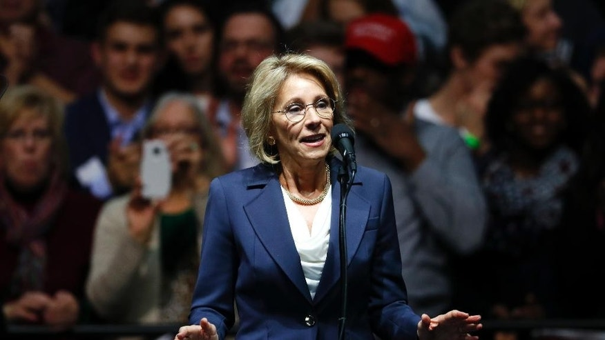 FILE - In this Dec. 9, 2016 file photo, Education Secretary-designate Betsy DeVos speaks in Grand Rapids, Mich.  DeVos, Trump's choice for education secretary, has spent over two decades advocating for school choice programs, which give students and parents an alternative to traditional public school education. Her confirmation hearing was scheduled for Jan. 17. (AP Photo/Paul Sancya, File)