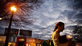 A woman heads to a yoga class as dusk falls in East Atlanta, Ga., in Dekalb County, Wednesday, Jan. 11, 2017. The county is a Democratic stronghold east of downtown Atlanta. Hillary Clinton won four out of five DeKalb votes, capitalizing on a heavy African-American population, a burgeoning Hispanic community and a bevy of white liberals, many of them from elsewhere. (AP Photo/David Goldman)
