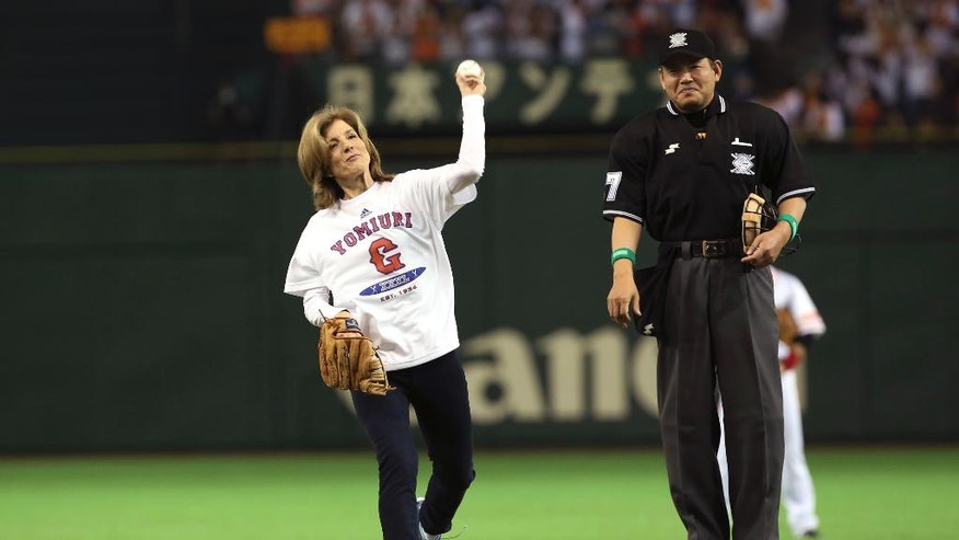 FILE - In this March 28, 2014, file photo, U.S. Ambassador to Japan Caroline Kennedy throws out the ceremonial first pitch before the Japan's Central League professional baseball opening game between the Yomiuri Giants and the Hanshin Tigers at Tokyo Dome in Tokyo. Kennedy is stepping down Wednesday, Jan. 18, 2017 after three years as U.S. ambassador to Japan, where she was welcomed like a celebrity and worked to deepen the U.S.-Japan relationship despite regular flare-ups over American military bases on the southern island of Okinawa. (AP Photo/Eugene Hoshiko, File)