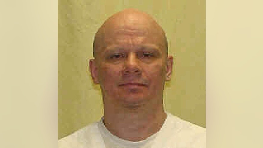 This undated photo provided by the Ohio Department of Rehabilitation and Correction shows death row inmate Robert Van Hook, convicted of the fatal 1985 strangling and stabbing of David Self, a man he met in a bar in Cincinnati. Van Hook's lawyers asked a federal magistrate Tuesday, Jan. 17, 2017, to allow them to challenge Ohio's new three-drug execution method. (Ohio Department of Rehabilitation and Correction via AP)