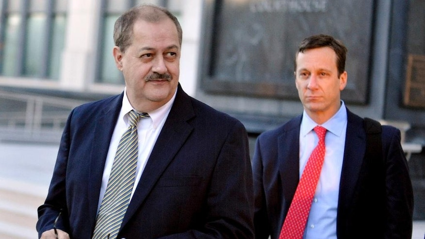 FILE - In a Tuesday, Nov. 24, 2015 file photo, former Massey Energy CEO Don Blankenship, left, walks out of the Robert C. Byrd U.S. Courthouse after the jury deliberated for a fifth full day in his trial, in Charleston, W.Va.  A federal appeals court has affirmed the conviction of former Massey Energy CEO Don Blankenship in connection with the deadliest U.S. mine disaster in four decades. The 4th U.S. Circuit Court of Appeals handed down the opinion Thursday, Jan. 19, 2017, saying it found no reversible errors in trial rulings. (AP Photo/Chris Tilley, File)