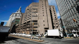"FILE- This March 12, 2009 photo shows the Metropolitan Correctional Center in New York City. The high security section of the facility where high-risk inmates that included Mafia boss John Gotti and several close associates of Osama bin Laden spent their time awaiting trial, will now house accused Mexican drug lord and escape artist Joaquin ""El Chapo"" Guzman. (AP Photo/Mark Lennihan, File)"