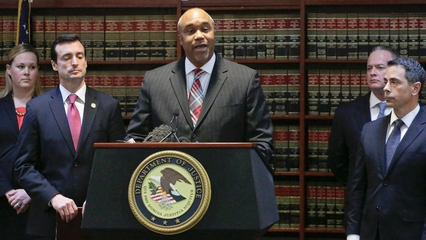 "U.S. attorney Robert Capers, center, speaks during a news conference, announcing charges for Mexican drug kingpin Joaquin ""El Chapo"" Guzman as the murderous architect of a three-decade-long web of violence, corruption and drug trafficking, Friday Jan. 20, 2017, in the Brooklyn borough of New York.  Extradited Thursday from Mexico, Guzman was due later Friday in a federal court in Brooklyn. Prosecutors have sought to bring him to a U.S. court for years while he made brazen prison escapes and spent years on the run in Mexico.  (AP Photo/Mark Lennihan)"