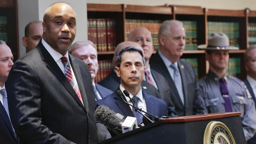 "U.S. attorney Robert Capers, left, speaks during a news conference, announcing charges for Mexican drug kingpin Joaquin ""El Chapo"" Guzman as the murderous architect of a three-decade-long web of violence, corruption and drug trafficking, Friday Jan. 20, 2017, in the Brooklyn borough of New York.  Extradited Thursday from Mexico, Guzman was due later Friday in a federal court in Brooklyn. Prosecutors have sought to bring him to a U.S. court for years while he made brazen prison escapes and spent years on the run in Mexico.  (AP Photo/Mark Lennihan)"