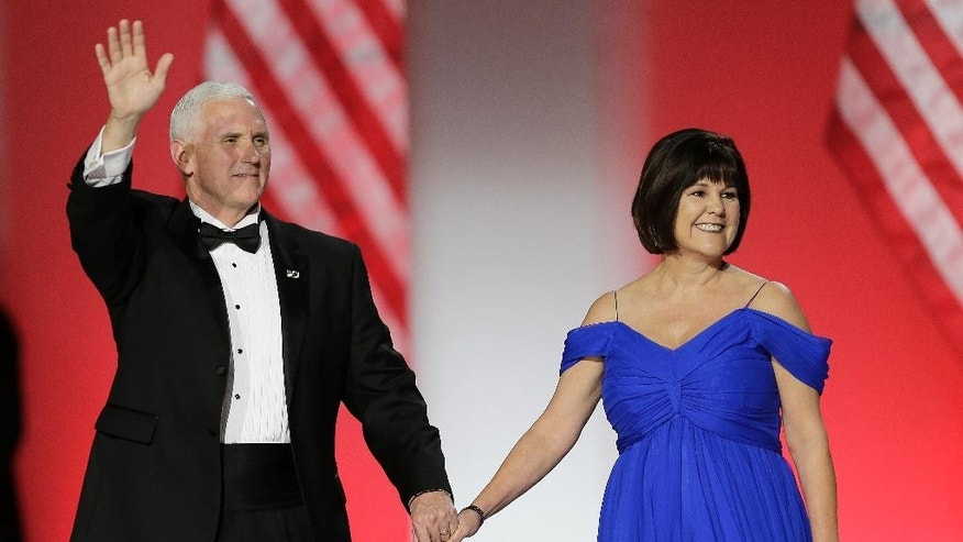 Vice President Mike Pence and his wife Karen Pence arrive at the Freedom Ball in Washington, on Friday, Jan. 20, 2017, at the Washington Convention Center during the 58th presidential inauguration. (AP Photo/Mark Tenally)