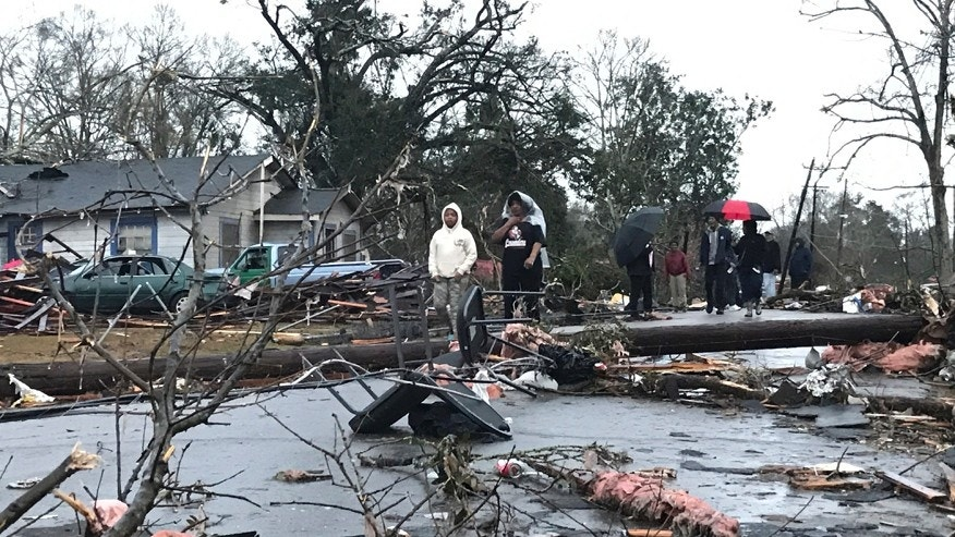 Trees and debris cover the ground after a tornado tornado ripped through the Hattiesburg, Miss., area early Saturday, Jan. 21, 2017