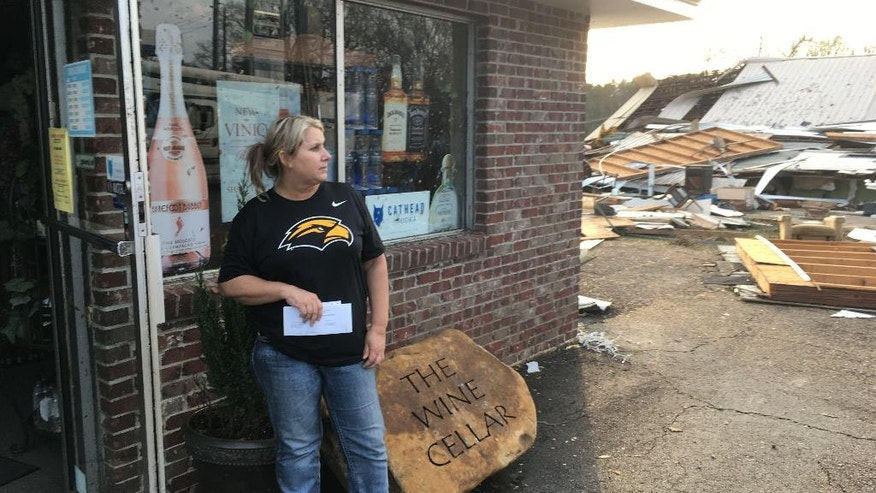 Liquor store owner Cynthia Holland says she'll repair her liquor store in Petal, Mississippi, following a predawn tornado on Saturday, Jan., 21, 2017. Holland, though, says she's worried about money and what her employees will do while the store is closed. . Petal Mayor Hal Marx says more than 300 homes and 30 businesses were damaged in his 10,000-resident city, along with hundreds more in its larger neighbor of Hattiesburg. The twister plowed a 25-mile path across south Mississippi, killing four people and injuring dozens. (AP Photo/Jeff Amy)