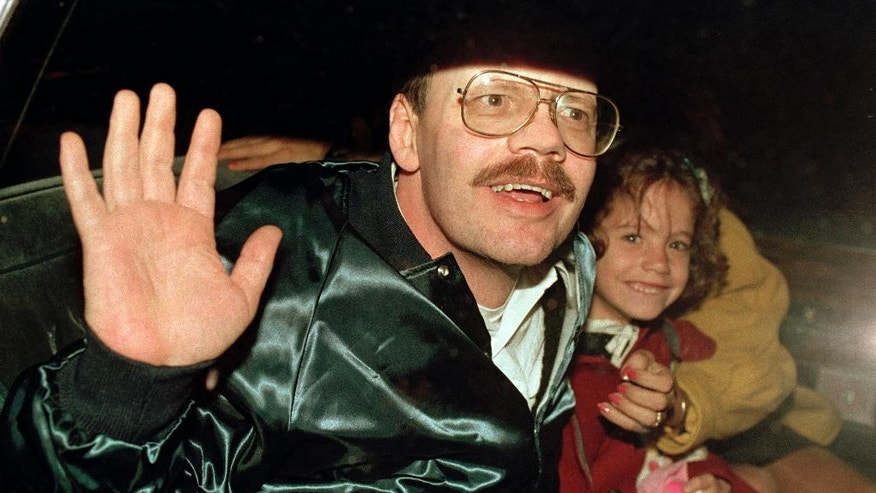 "FILE - In this Dec. 4, 1991, file photo Terry Anderson, who was the longest held American hostage in Lebanon, grins with his 6-year-old daughter Sulome as they leave the U.S. Ambassador's residence in Damascus after Anderson's release. Sulome said a multi-year retracing of her father's harrowing ordeal repaired their tattered relationship. Sulome describes the quest in ""The Hostage's Daughter,"" a recently published book. Her effort to research the 1985 kidnapping of Terry Anderson in Beirut, Lebanon, eventually brought her face-to-face with one of his captors. Ultimately, it led her to see eye-to-eye with her father again. (AP Photo/Santiago Lyon, File)"