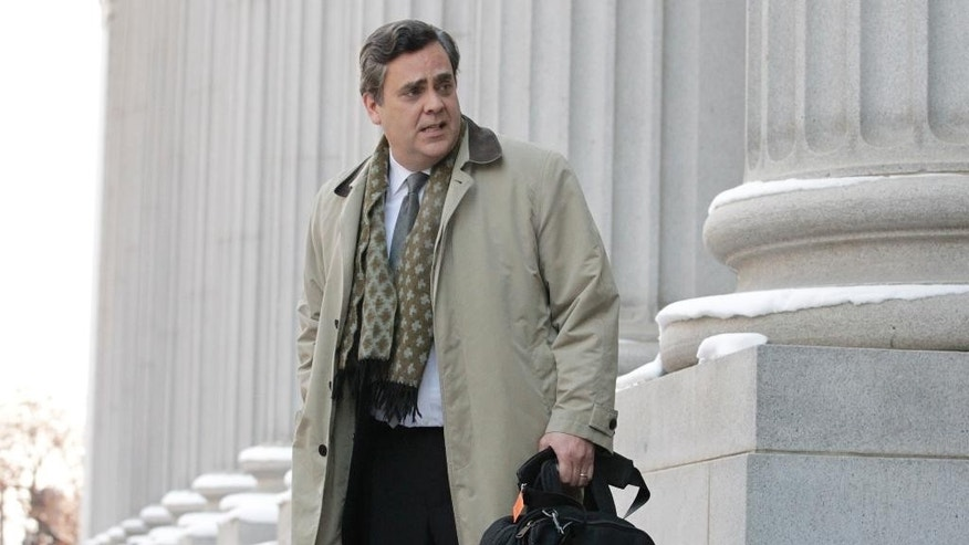 "FILE - In this Jan. 17, 2013, file photo, Jonathan Turley, attorney for Kody Brown and his four wives, the stars of the reality show ""Sister Wives,"" leaves the Frank E. Moss United States Courthouse, in Salt Lake City. The Supreme Court said Monday, Jan 23, 2017, it won't hear an appeal from the family on TV's ""Sister Wives"" challenging Utah's law banning polygamy. The decision ends the family's long legal fight to overturn a seldom used and unique provision of Utah's law that the Browns and other polygamous families contend has a chilling effect by sending law-abiding plural families into hiding because of fear of prosecution. (AP Photo/Rick Bowmer, File)"