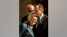 FILE - In this Nov. 6, 1997, file photo, former President George H.W. Bush hugs his wife, Barbara, after speaking at the dedication of the George Bush Presidential Library in College Station, Texas. The Bushes were married Jan. 6, 1945, and have had the longest marriage of any presidential couple in American history. (AP Photo/Pat Sullivan, File)