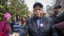 "U.S. Rep. John Lewis reaches out to shake the hands of well-wishers as he arrives at the Women's March on Saturday, Jan. 21, 2017, in Atlanta. The rally and march drew thousands of attendees, including , U.S. Rep. John Lewis, who had been at odds with president Donald Trump leading up to the inauguration. At the rally, Lewis told The AP, ""We've made progress, but there are forces in America that want to take us back to another time and another place."" (AP Photo/Ron Harris)"