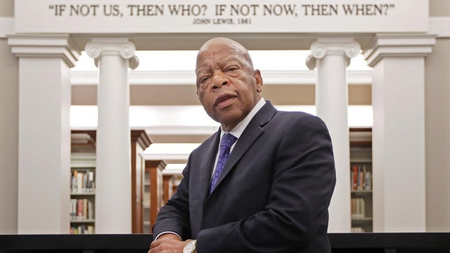 "FILE - This Nov. 18, 2016 file photo shows Rep. John Lewis, D-Ga., in the Civil Rights Room in the Nashville Public Library in Nashville, Tenn. The American Library Association announced Monday that the Georgia Democrat received four prizes Monday, Jan. 23, 2017. for ""March: Book Three,"" the last of a graphic trilogy about his civil rights activism and winner last fall of the National Book Award. (AP Photo/Mark Humphrey, File)"