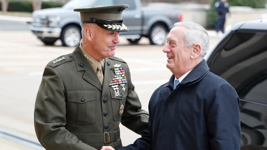 "FILE - In this Jan. 21, 2107 file photo, Joint Chiefs Chairman Gen. Joseph Dunford greets Defense Secretary James Mattis at the Pentagon. The Trump administration opened the door to cooperating with Russia ""or anyone else"" to combat the Islamic State group in Syria, suggesting it could reverse a previous refusal to coordinate military action with Moscow as long as it backs the Syrian government. (AP Photo/Alex Brandon, File)"