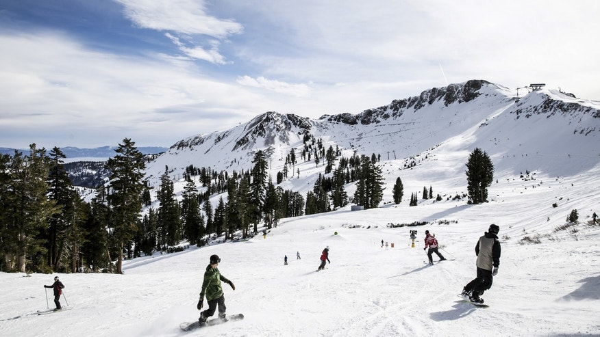 Skiers and snowboarders enjoy the slopes at Squaw Valley in Olympic Valley, California, December 5, 2015.