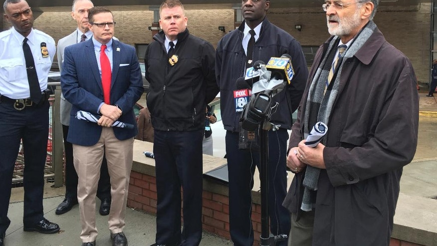 Cleveland Mayor Frank Jackson, right, speaks at a news-conference Tuesday, Jan.24, 2017, in Cleveland. Cleveland officials have identified the police officer killed in a hit-and-run on an interstate as Patrolman David Fahey. Fahey was helping Lakewood police and firefighters Tuesday morning after an accident involving a firetruck and a van on Interstate 90 when he was struck. A Cleveland police union official says Fahey was setting up flares at the time. (AP Photo/Mark Gillispie)
