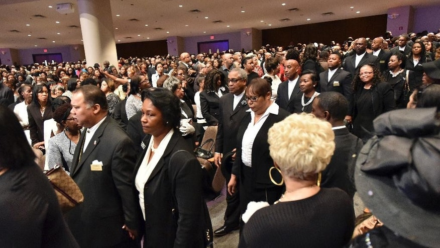 Mourners fill the sanctuary during during a service to celebrate the life of Eddie Long, senior pastor, at New Birth Missionary Baptist Church, Wednesday, Jan. 25, 2017, in Lithonia, Ga. Long, a Georgia megachurch pastor who died Jan. 15 after battling cancer. (Hyosub Shin/Atlanta Journal-Constitution via AP)
