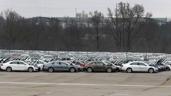 In this Tuesday, Jan. 24, 2017, photo, Volkswagen vehicles are stored at the vacant Silverdome in Pontiac, Mich. The Volkswagen TDIs are in the center of the emissions scandal forcing Volkswagen to buy back those vehicles affected. (AP Photo/Carlos Osorio)