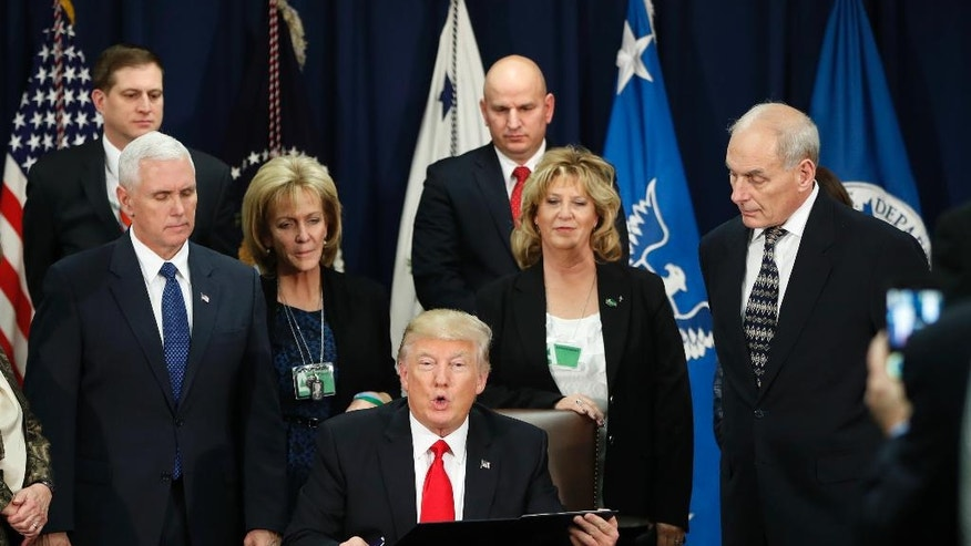 President Donald Trump, accompanied by Vice President Mike Pence, Homeland Security Secretary John F. Kelly, and others, speaks during a visit to the Homeland Security Department in Washington, Wednesday, Jan. 25, 2017. (AP Photo/Pablo Martinez Monsivais)