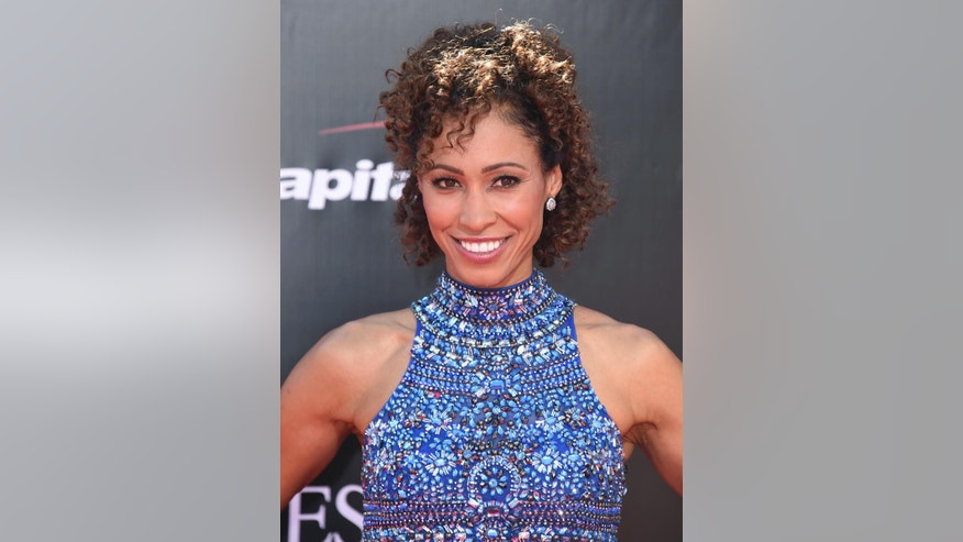 FILE - In this Wednesday, July 13, 2016, file photo, Sage Steele arrives at the ESPY Awards at the Microsoft Theater in Los Angeles. Steele, an ESPN anchor who vented about missing her flight Sunday, Jan. 29, 2017, on Instagram because of airport immigration protesters, is drawing criticism from people who say she is being insensitive. (Photo by Jordan Strauss/Invision/AP, File)
