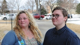 Jessie Lamphere, a transgender high school student, stands with his mom, Tyler Lamphere, left, after a brief hearing at the state Capitol in Pierre, S.D., Tuesday, Jan. 31, 2017. A bill that would have restricted which locker rooms South Dakota transgender students could use was withdrawn Tuesday. (AP Photo/James Nord)