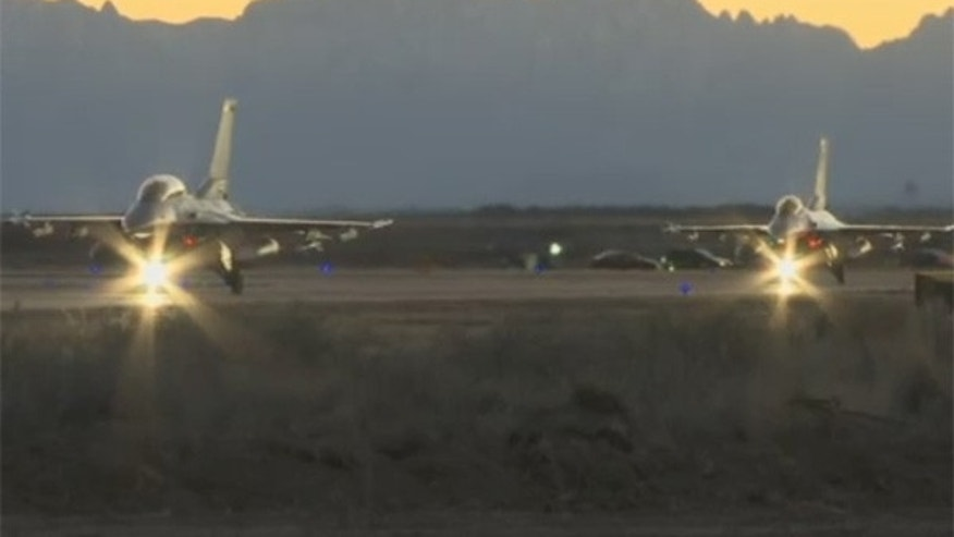 Two F-16s take off from Holloman Air Force Base.