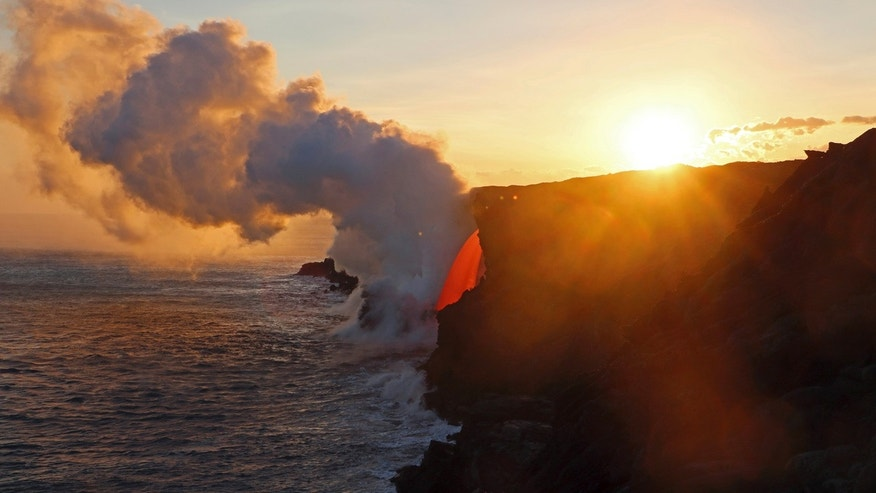 This Jan. 29, 2017 photo provided by the U.S. Geological Survey shows a lava stream pouring out of a lava tube on the sea cliff at the Kamokuna ocean entry at the Hawaii Volcanoes National Park on the Big Island of Hawaii.