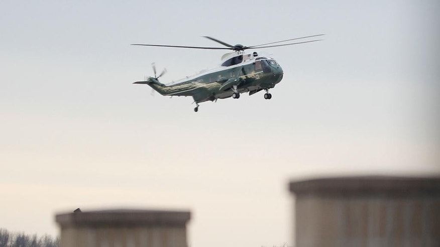 "Marine One, with President Donald Trump aboard, lands at Dover Air Force Base, Del. Wednesday, Feb. 1, 2017. Trump traveled to Dover AFB to meet with family members Chief of Special Warfare Operator William ""Ryan"" Owens, 36, of Peoria, Ill, the U.S. service member who was killed in a raid in Yemen, and who's remains where returned today. Owens is the first-know combat death of a member of the U.S. military under Trump's administration. (AP Photo/Pablo Martinez Monsivais)"