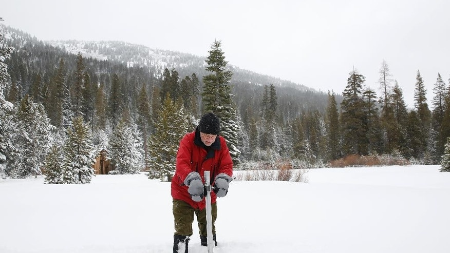 FILE - In this Jan. 3, 2017, file photo, Frank Gehrke, chief of the California Cooperative Snow Surveys Program for the Department of Water Resources, plunges the survey tube into the snowpack as he conducts the first snow survey of the season at Phillips Station near Echo Summit, Calif. Nothing but good news is expected when California does its next regular Sierra snow surveys after last month's huge storms. The state snow survey on Thursday, Feb. 2, 2017, is important because California gets about a third of its water from Sierra runoff in typical years. (AP Photo/Rich Pedroncelli, File)