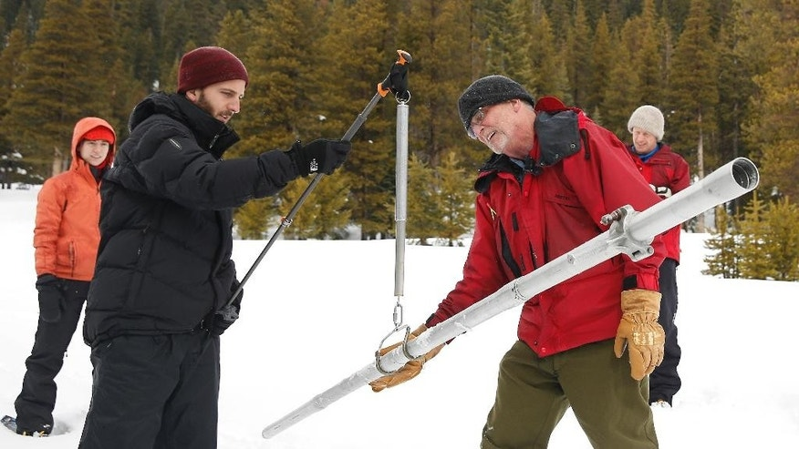 Frank Gehrke, right, chief of the California Cooperative Snow Surveys Program for the Department of Water Resources, checks the weight of the snow sample on a scale held by Mikel Shybut, a policy fellow with the California Council on Science and Technology, during the second manual snow survey of the season at at Phillips Station Thursday, Feb. 2, 2017, near Echo Summit, Calif.   (AP Photo/Rich Pedroncelli)