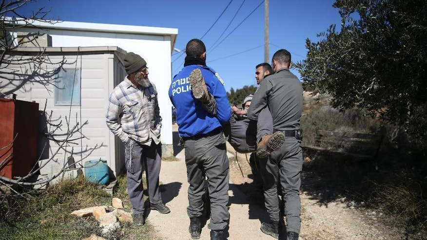Israeli police evicts settlers from the West Bank outpost of Amona, Thursday, Feb. 2, 2017. Israeli police  removed the remaining Israeli protesters from the West Bank outpost of Amona, which forces are evacuating under court order. The evacuation began Wednesday. Amona is the largest of about 100 unauthorized outposts erected in the West Bank without formal permission but with tacit Israeli government support. The outpost was found to be built on private Palestinian land and the Israeli Supreme Court ordered it demolished. (AP Photo/Oded Balilty)