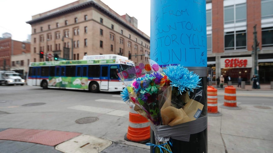 A makeshift memorial put up by Denver Police is affixed to a pole early Wednesday, Feb. 1, 2017, near the scene where a contract transit security officer was shot and killed late Tuesday, Jan. 31 in Denver.