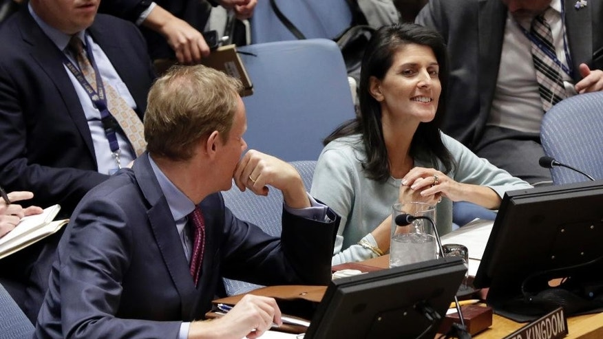 The new U.S. Ambassador to the U.N. Nikki Haley, right, and Britain's U.N. Ambassador Matthew Rycroft attend a Security Council meeting of the United Nations, Thursday, Feb. 2, 2017. (AP Photo/Richard Drew)