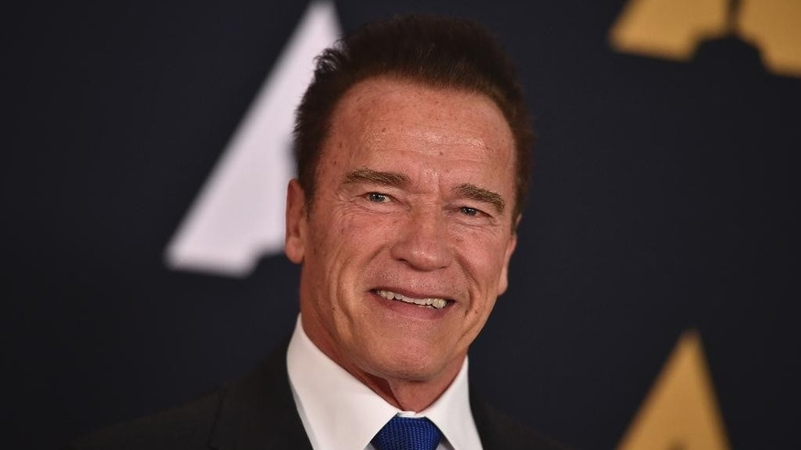 "FILE - In this Nov. 12, 2016 file photo, Arnold Schwarzenegger is seen in Los Angeles. President Donald Trump is seeking prayers for Schwarzenegger over ratings for ""Celebrity Apprentice,"" the show Trump once hosted. Addressing the National Prayer Breakfast in Washington, Thursday, Feb. 2, 2017, Trump said ratings went ""right down the tubes"" and the show's been a ""total disaster"" since the actor and former California governor debuted as host last month.  (Photo by Jordan Strauss/Invision/AP, File)"