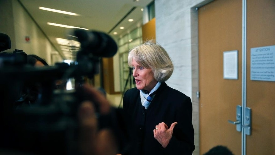 Denver's new District Attorney Beth McCann speaks with reporters following a hearing for homicide suspect Joshua A. Cummings, accused of killing a Denver transit guard days earlier at point-blank range, at court in Denver, Friday, Feb. 3, 2017. (AP Photo/Brennan Linsley)