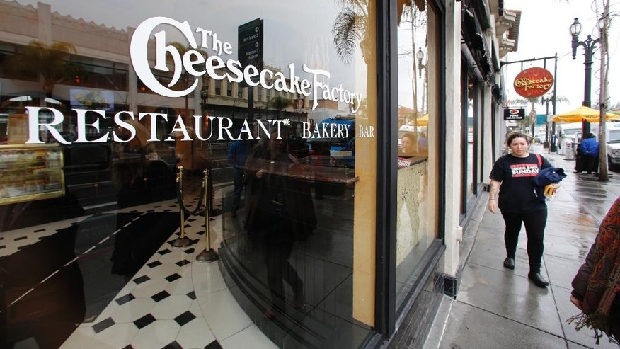 "The Cheesecake Factory restaurant is seen in Old Pasadena Friday, Feb. 3, 2017. A man dressed in black threw a homemade incendiary device into the crowded California restaurant Thursday at dinnertime, and when it ignited, panicked patrons abandoned their meals and knocked over chairs as they rushed for the exits. But no one was hurt. Authorities described it as ""homemade pyrotechnic device"" but did not disclose its contents. Police is still looking for the man who threw it. The restaurant reopened Friday. (AP Photo Damian Dovarganes)"
