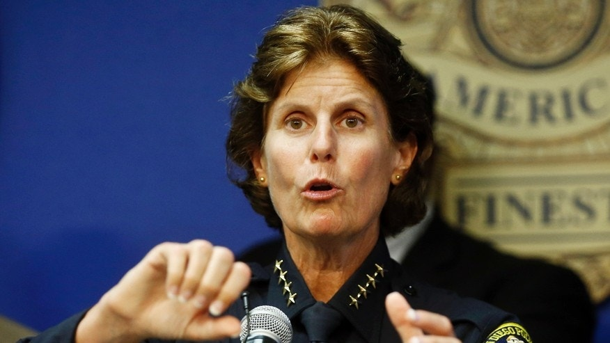 FILE - In this Sept. 9, 2015 file photo, San Diego Police Chief Shelley Zimmerman talks about the results of the first year of body cameras being worn by approximately 800 police officers in San Diego. Zimmerman is among the growing number of women heading departments, many in need of image makeovers.   (AP Photo/Lenny Ignelzi, File)