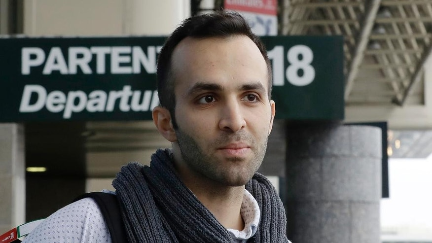 Iranian-born bioengineer researcher Nima Enayati in interviewed by the Associated Press, at the Milan's Malpensa International airport in Busto Arsizio, Italy, Sunday, Feb. 5, 2017. Just hours after an appeals court blocked an attempt to re-impose the travel ban, Iranian researcher Nima Enayati checked in on an Emirates Airline flight direct from Milan's Malpensa airport to New York's JFK on Sunday afternoon.  (AP Photo/Antonio Calanni)